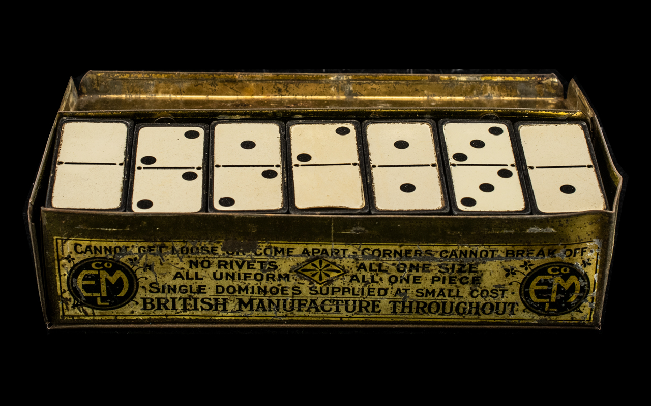 Advertising Interest early 20th century domino set in original box, made by E.M. patent number 8436.