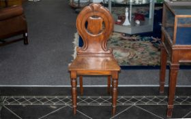 Victorian Mahogany Hall Chair with a Shaped Shield Back on Turned Legs.