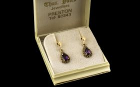 Boxed Set of 9ct Gold Amethyst Drop Earrings, from Thos. Yates of Preston, in original gift box.