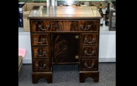 A Modern Mahogany Kneehole Desk, long frieze drawer above two banks of three drawers with central