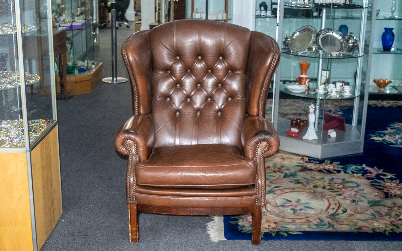 Gents Wing Back Chesterfield Armchair in brown, with lovely age patination, wear to arms and small