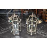 A Pair of Reproduction Brass Hanging Lanterns Electrified with Bevel glass panels in the