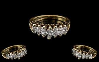 14ct Gold Attractive Contemporary Design 7 Stone Diamond Set Ring.