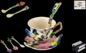 Collection of Franz Porcelain, to include a cabinet cup, saucer and spoon, design FZ00038,