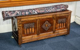 Reproduction Carved Oak Mule Chest with a Three Paneled Lift up Lid and Parcels to the Front.. 53