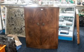 A Mid Century Bow Fronted Walnut Finish Cocktail Cabinet. Hinged Top with Maple Leaf Veneer, The
