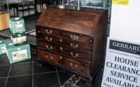A Walnut George III Bureau with full front, fitted interior with various pigeon holes, central