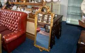 A Collection of Three Modern Decorative Gilt Mirrors, gilded wood, in the French Rococo style.