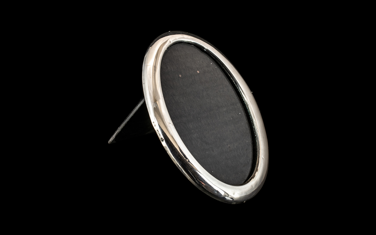 George V Oval Shaped Sterling Silver Photo Frame with Mahogany Back. Hallmark Birmingham 1925.