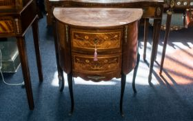 A French Demi Lune Two Drawer Inlaid Commode, chest of traditional form with small ormolu mounts,