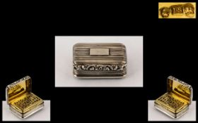 A George III Silver Vinaigrette of heavy form, fluted rectangular style, with a moulded edge.