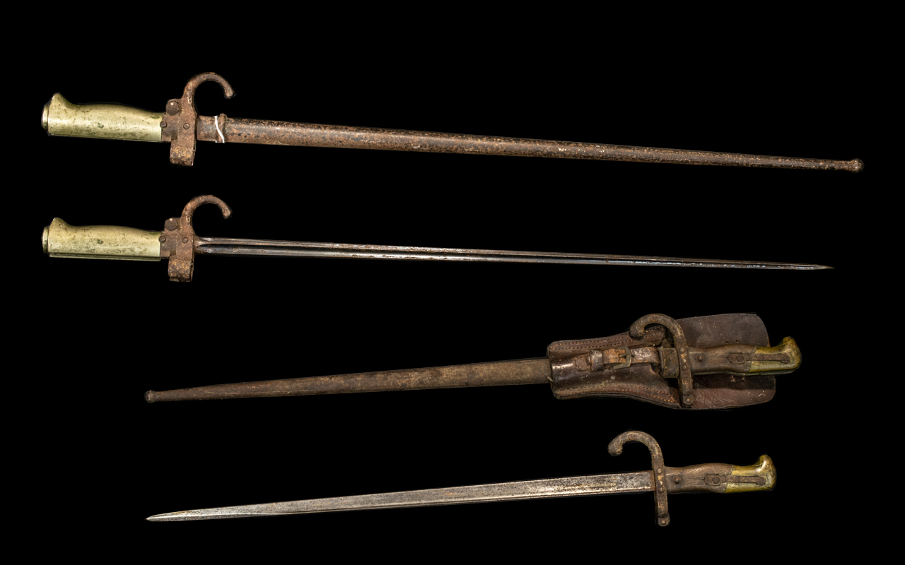 Two Antique French Bayonets in original scabbards comprising Model 1886 Epee and Model 1878