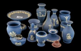 Collection of Wedgwood Blue Jasper, comprising a footed dish, a table lighter, a candle holder,