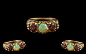 Antique Period - Attractive 9ct Gold 3 Stone Opal and Garnet Set Dress Ring - In a Gallery Setting.