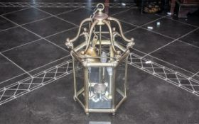 A Reproduction Brass Hanging Lantern Electrified with Bevel glass panels in the traditional English