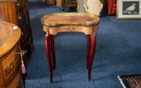 A Small French Reproduction Kidney Shaped Ormolu Mounted Side Table terminating on cabriole legs.