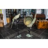 Pair of 20th Century Bronze Patinated Figures of Exotic Parrots (possibly Kakapo) perched on