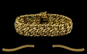 10ct Yellow Gold - Superb Quality Italian Snake Design Bracelet of Wide Proportions.