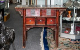 Chinese Antique Elm Altar Table of small proportions, with a red lacquered finish of typical Chinese