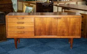 Swedish Designer Teak Credenza with a bank of four drawers and two cupboards,