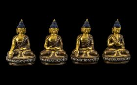Set of Four Small Seated Bronze Buddhas with different hand positions,