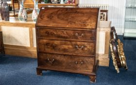 Georgian Mahogany Bureau of small size, with a fitted interior and three long drawers,