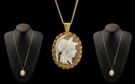 Ladies 9ct Gold Mounted Oval Shaped Shell Cameo Attached to a Long 9ct Gold Chain, Marked for 9ct