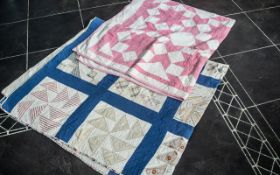 """Two Antique Quilts, one measures approx 6' x 6' 6"""" and is in a cream and blue colourway,"""