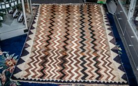 """Iranian Tribal Carpet with an interlacing chevron design in brown hues. Size 80"""" x 49""""."""
