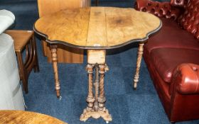 A Victorian Walnut Pembroke Table, of typical form, turned and carved supports,