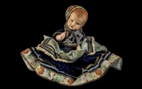 1920's Celluloid Doll In Its Original Clothing and Bonnet, Overall Length 12 Inches.