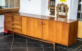 Swedish Designer Teak Credenza of Large Elegant Size constructed with a bank of five drawers to one