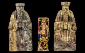 Three Chinese Soapstone Figures of Seated Deities, one decorated in coloured enamels; 7 inches (17.