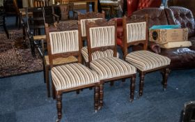 Four Edwardian Upholstered Walnut Dining Chairs, padded back and seat, together with a Begere seated