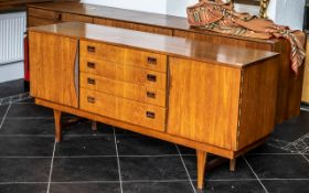 Teak Designer 1960's Sideboard fitted to the centre with a bank of four drawers,