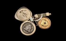 A 9ct Gold Sports Fob dated 1909, Champions St Anne's James Hughes.