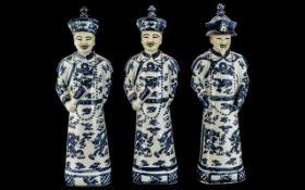 Set of Three Chinese Blue and White Porcelain Figures of Mandarins, 20thC,