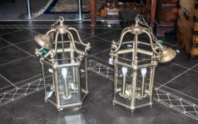 A Pair of Reproduction Brass Hanging Lanterns Electrified with Bevel glass panels in the traditional