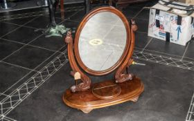 Victorian Mahogany Dressing Table Mirror, oval shaped raised on a semi-circular plinth, with opening