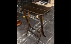 Mahogany Folding Table with cross supports, measures 62 cm wide x 30 cm deep x 76 cm tall approx.