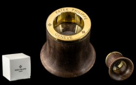 Patek Philippe Signed Jeweller's Loupe. Watch accessories, made from maple with gold coloured base.