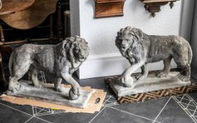 Pair of Reconstituted Medici Lions with their paws resting on a ball, weather-worn.