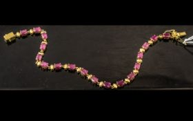 Ruby Tennis Bracelet, a line of oval cut rubies, red with a deep pink tone, making an unusual,