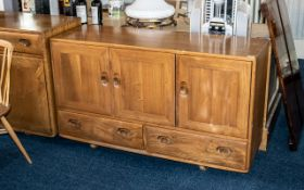 An Ercol Sideboard, Three Cupboards above two drawers, interior drawer for cutlery,