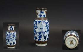 A Small Antique Chinese Blue & White Decorated Crackle ware Vase, with character mark to base.