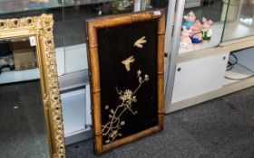 An Antique Japanese Ivory Panel depicting birds in flight,