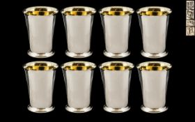 Elizabeth II Superb Set of Eight Sterling Silver Beakers / Cups, With Gilt Interior and of Tapered