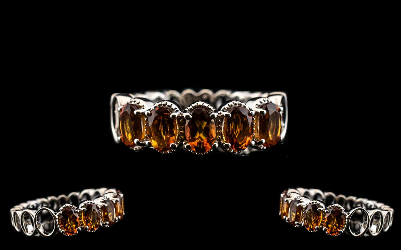 Madeira Citrine Band Ring, five oval cut, deep, warm Madeira citrines totalling 2cts, held within