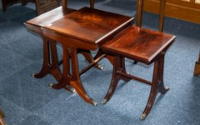Regency Style Mahogany Nest of Three Tables supported on reeded legs with cast brass paw feet