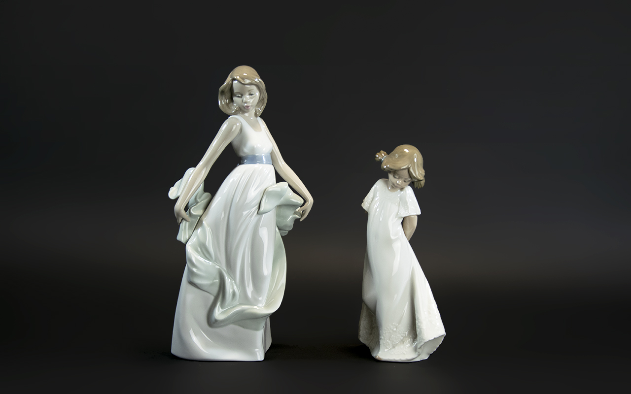 Two Nao Figures, comprising: a young lady with a shawl, 10'' tall; and a figure of a young child 8''